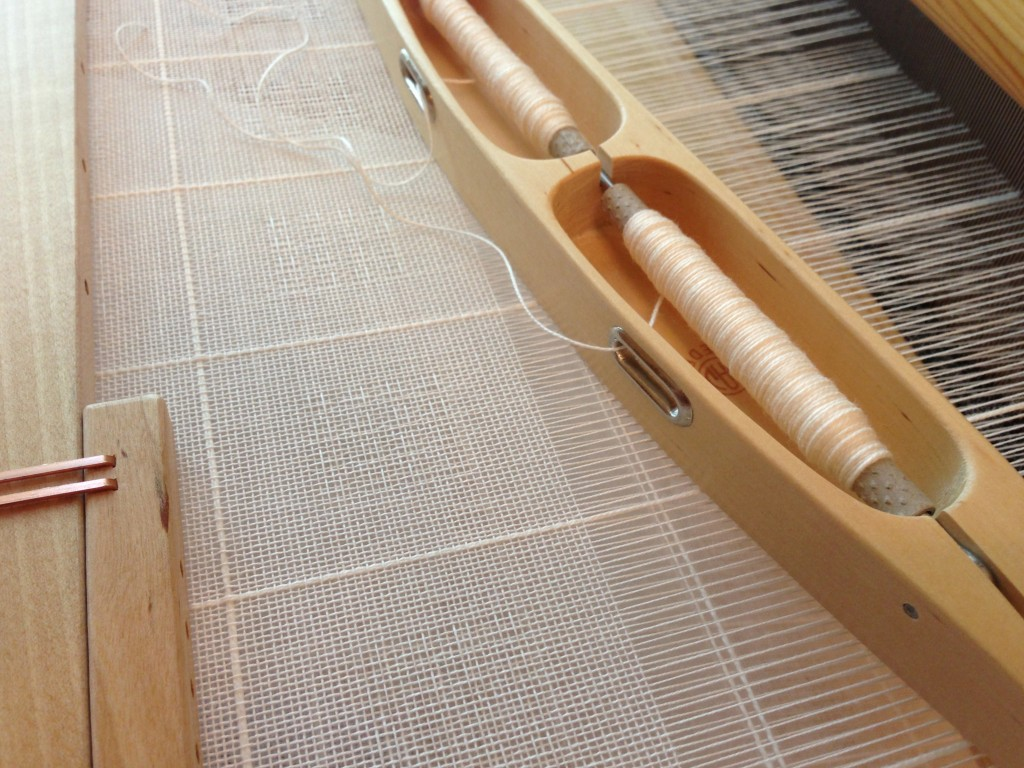 Handwoven Swedish lace using double bobbin shuttle