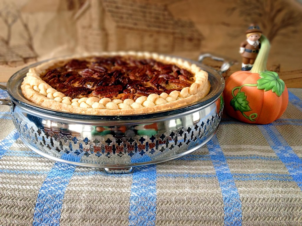 Handwoven eight-shaft two block twill cloth holds special Pecan Pie with braided-edged crust. Perfect finale for Thanksgiving dinner.