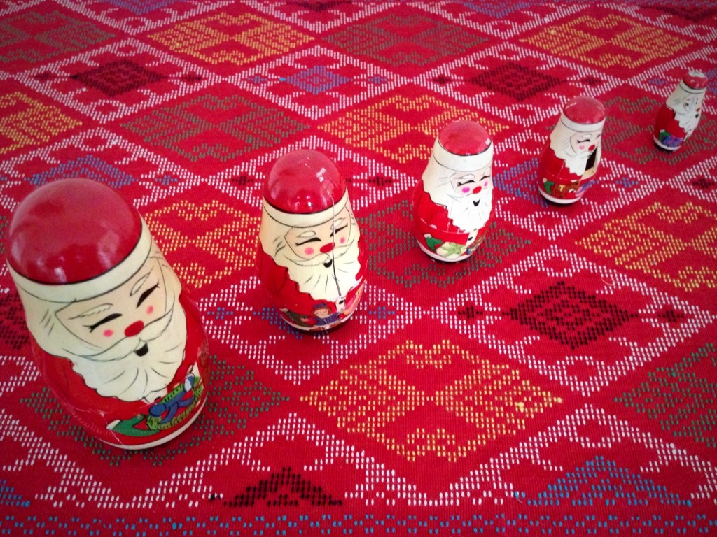 Handwoven design, unique to the Philippines, holds vintage Santa display.