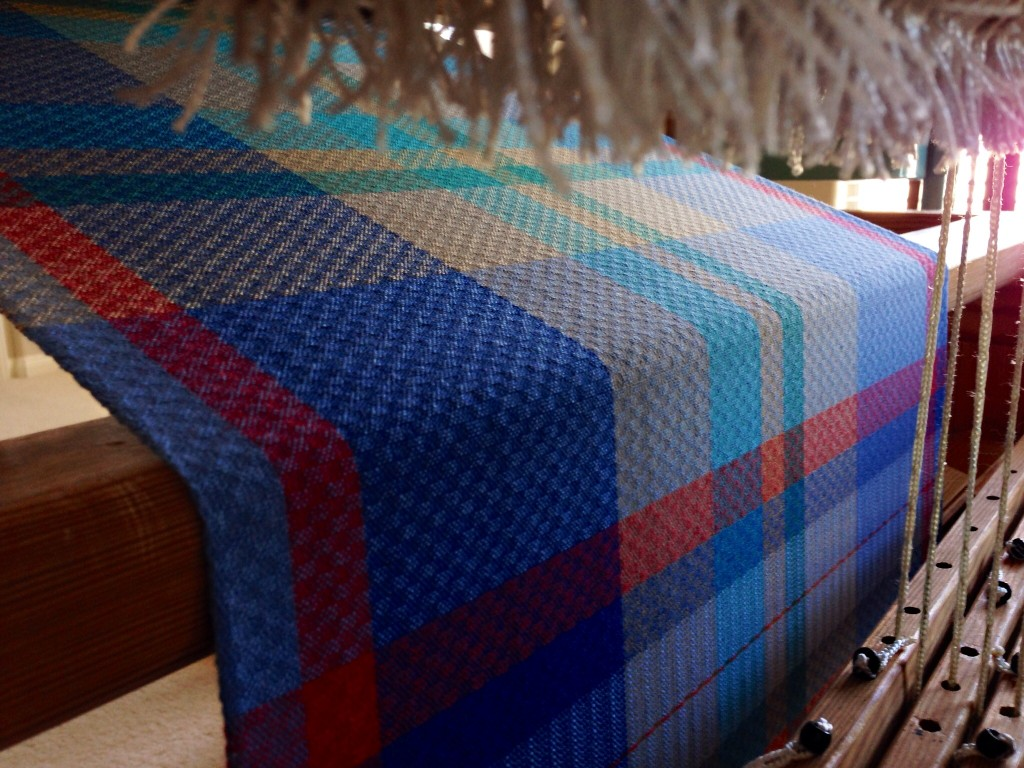 Cotton handtowels on the loom. View from back of loom under the warp.