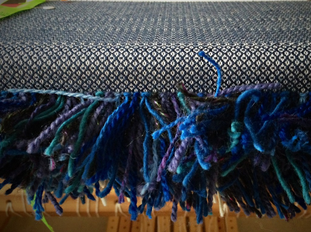 Rya knots for pillow. Back of pillow being woven in background weft.