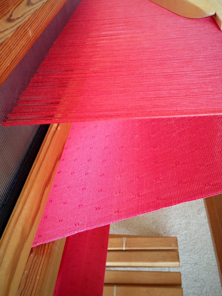 Coral pink bamboo shawl in huck lace.