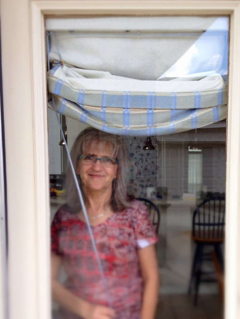 Opening the handwoven Roman shades. Please come on in!