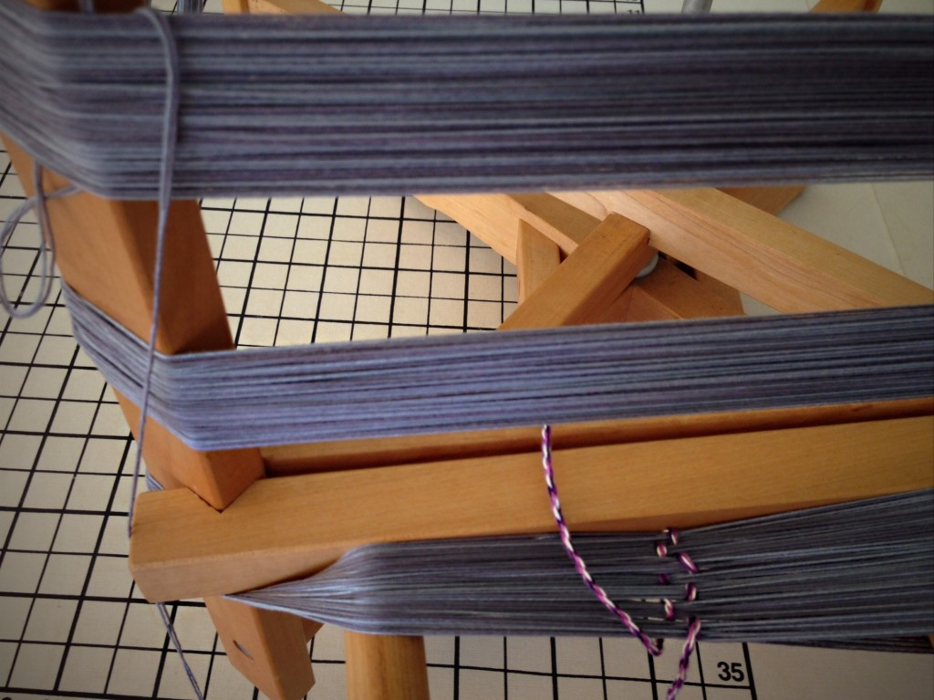 Winding rug warp on warping reel.