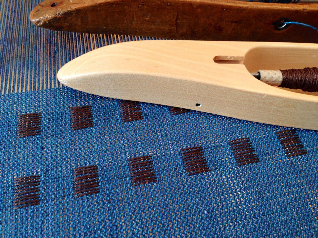 Dice weave on the loom, with the luster of linen in the warp and weft.