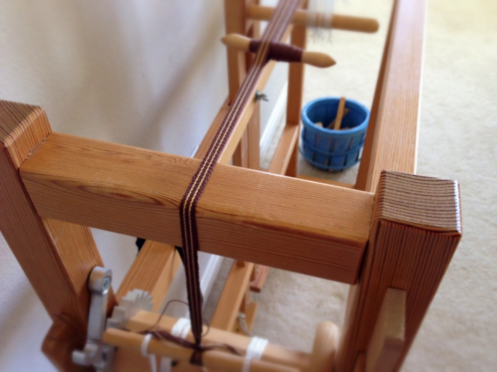 Band loom weaving, making hanging tabs for handwoven towels.