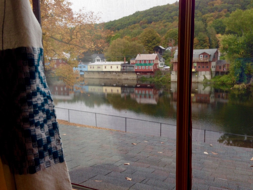 Handwoven curtains frame the view at Vavstuga student quarters.