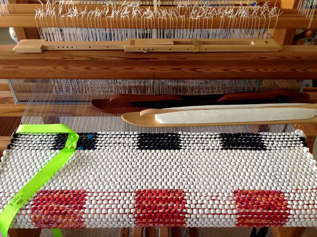 Double-binding rag rug on the loom.