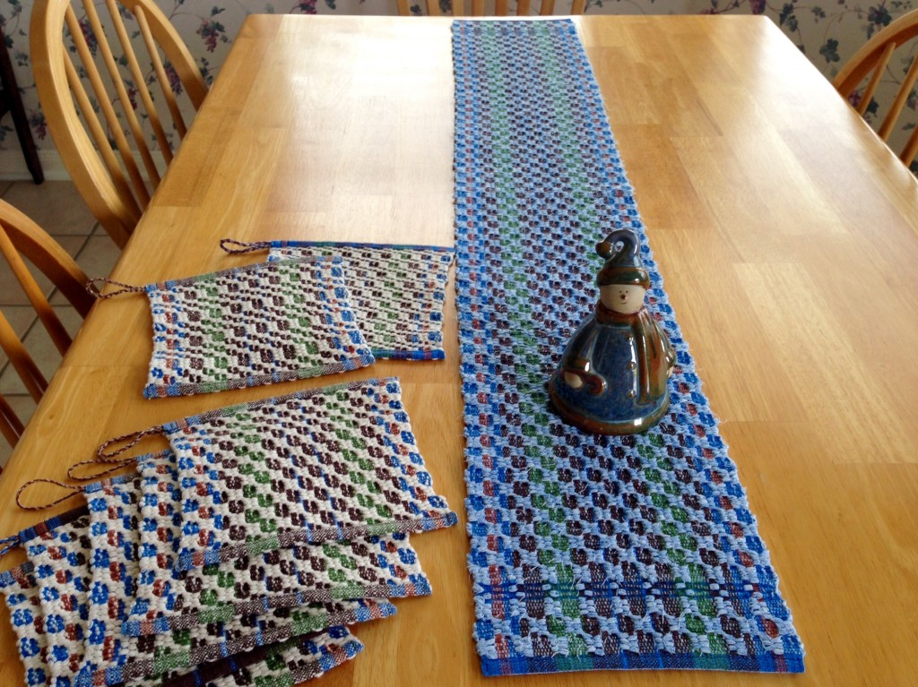 Rag weave table runner and string yarn pot holders in M's and O's. Karen Isenhower