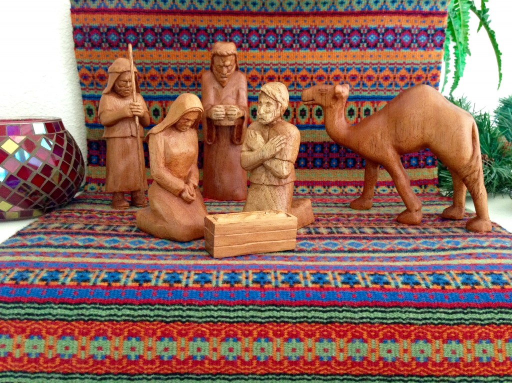 Hand-carved Nativity on handwoven bound rosepath. The Isenhowers.