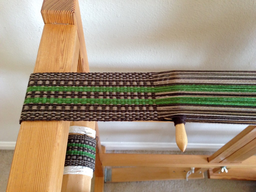 Weaving a sturdy strap on Glimakra band loom.