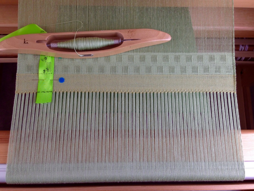 Cotton lace weave scarves on the loom. Fringe twisting info, too.