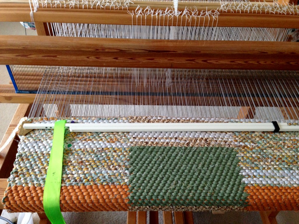 Double-binding twill rag rug on the loom.