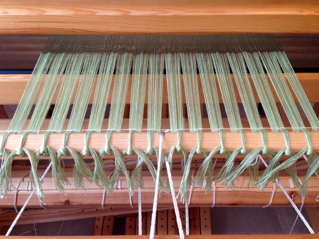 Cotton warp for scarves is tied on.