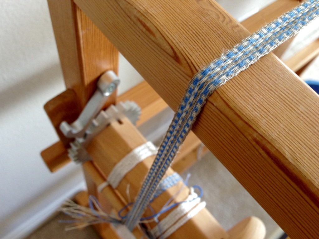 Linen band weaving on Glimakra two-treadle band loom.