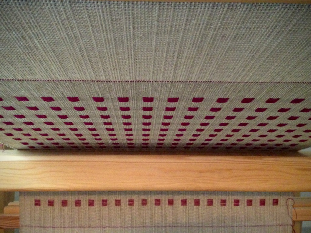 Dice weave on the loom. View from under the weaving.