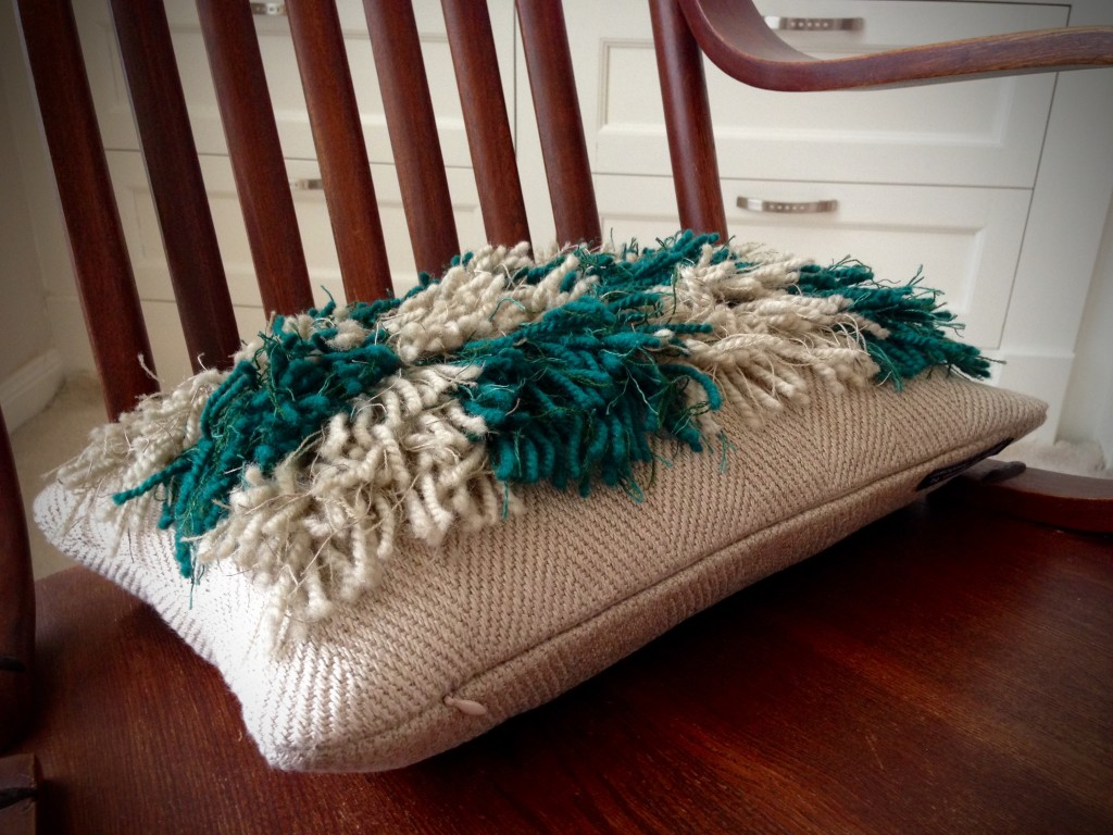 Finished handwoven rya pillow.