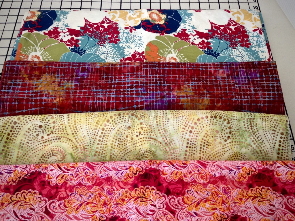 Choosing fabric for double binding rag rug.