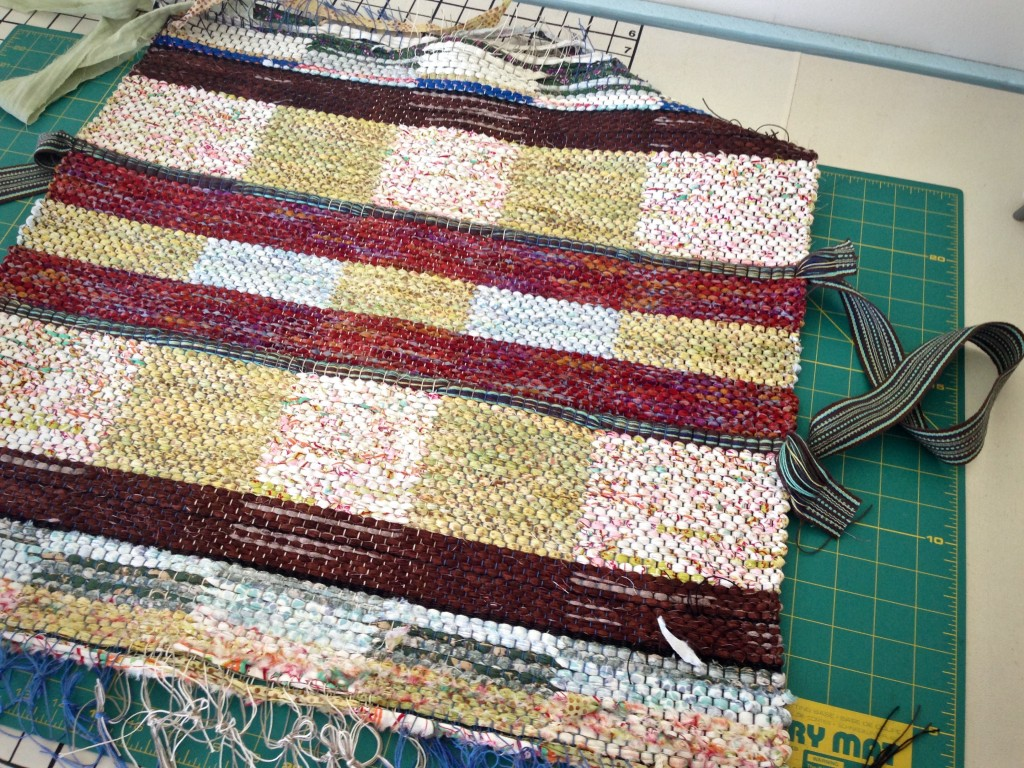 Finishing ends to make bag.