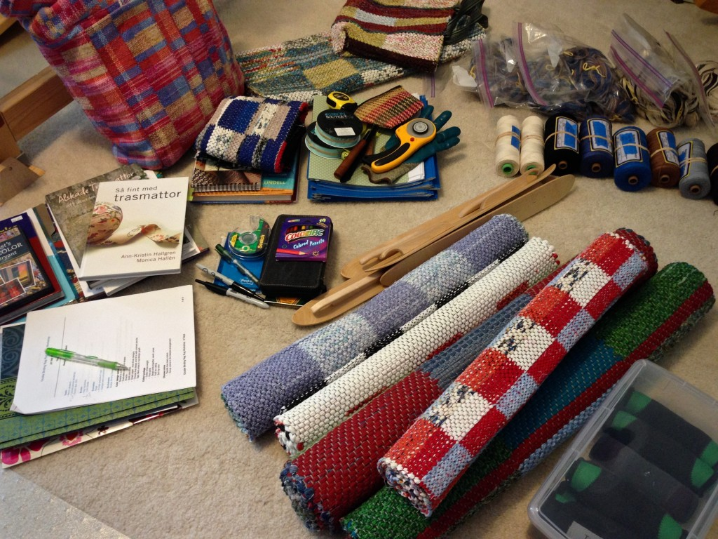 Gathering supplies to teach rag rug weaving class.