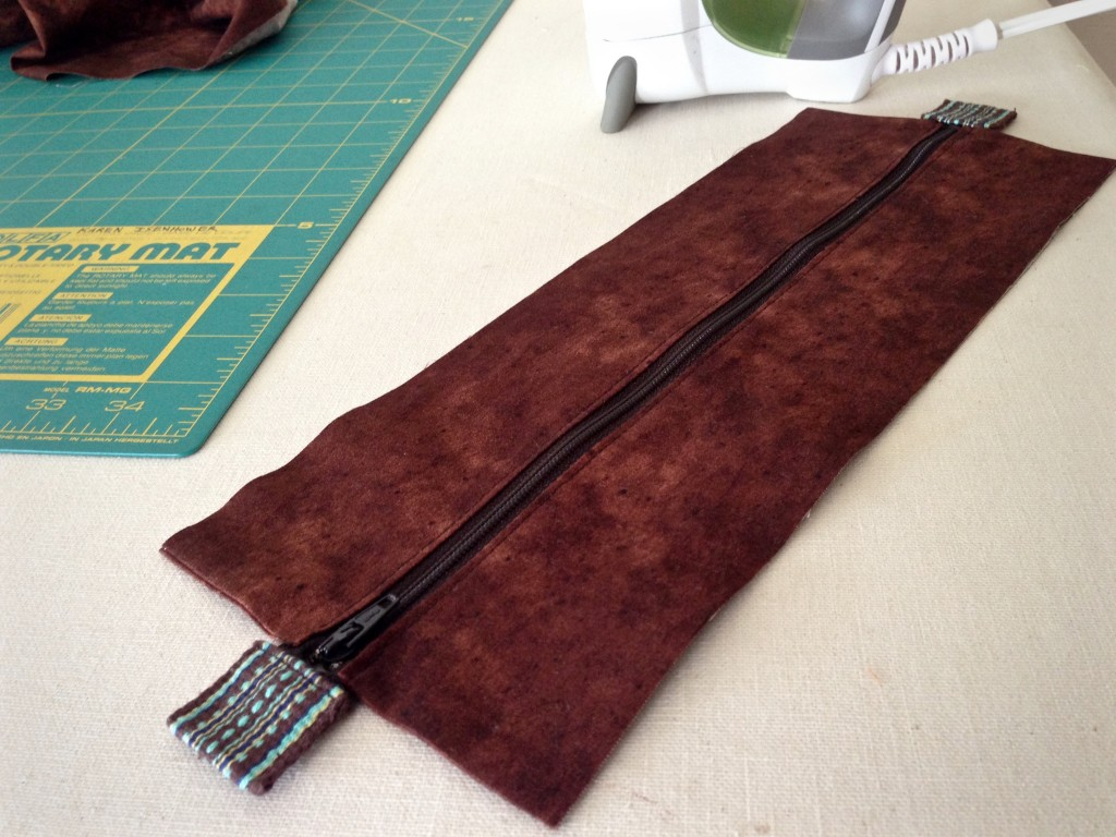 Adding zippered top to handwoven bag.