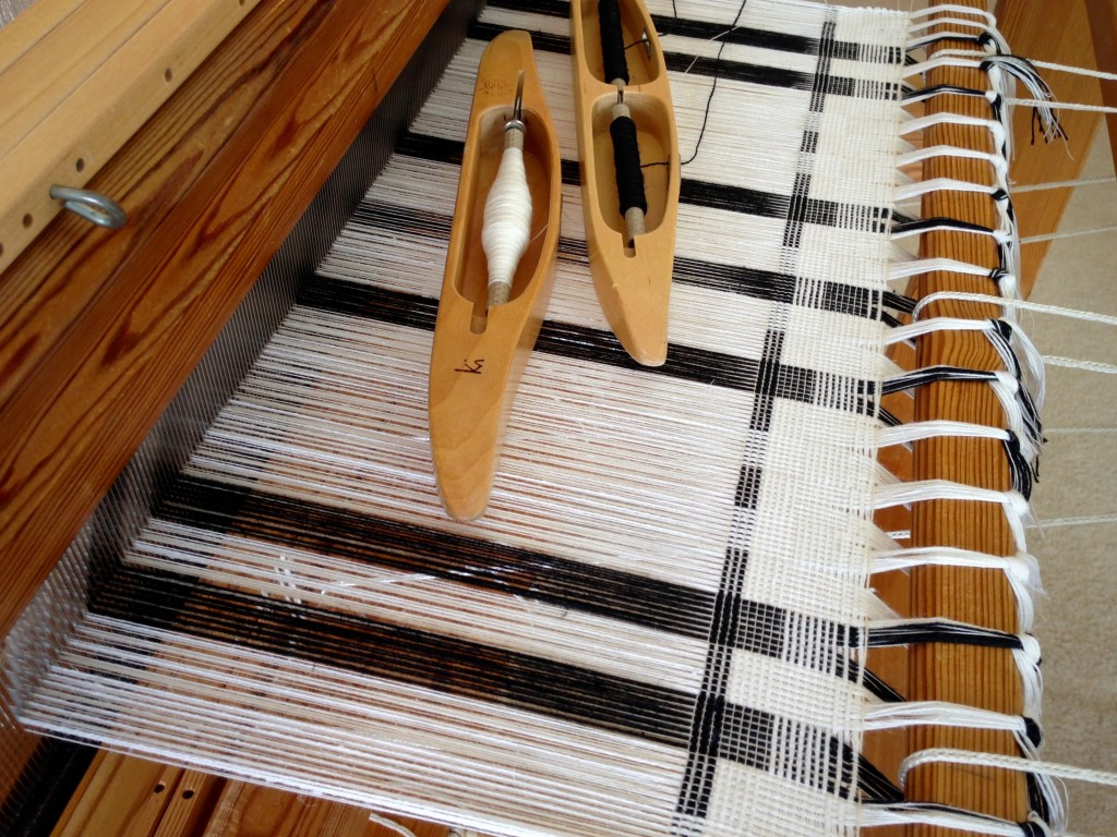 Black and white towels on the loom.