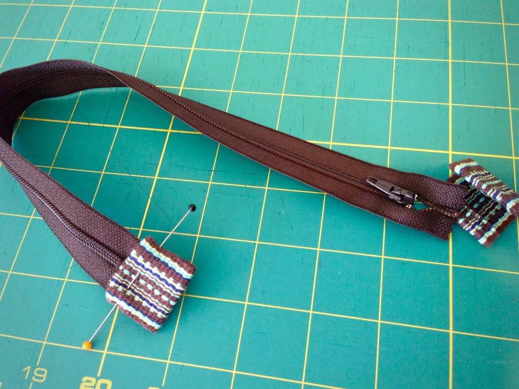 Preparing zipper to add to bag.