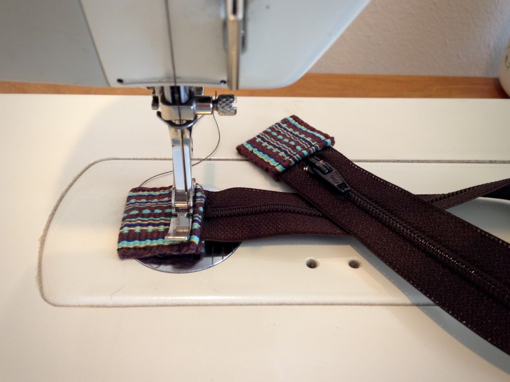 Handwoven tabs for ends of zipper tape.