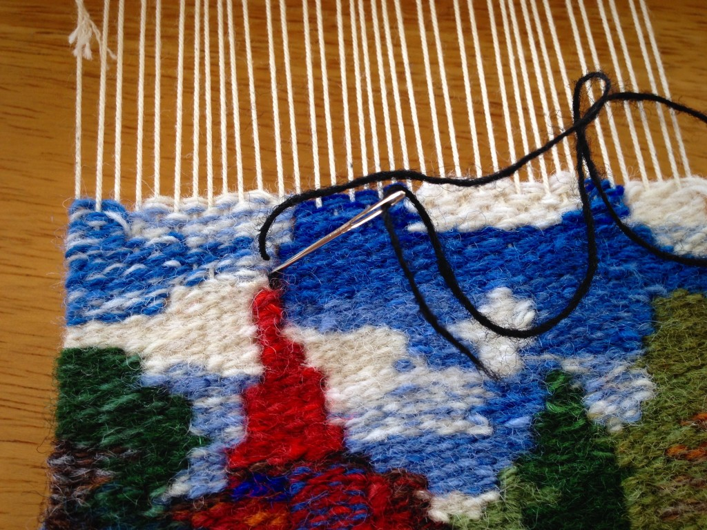Embroidery on a small tapestry.