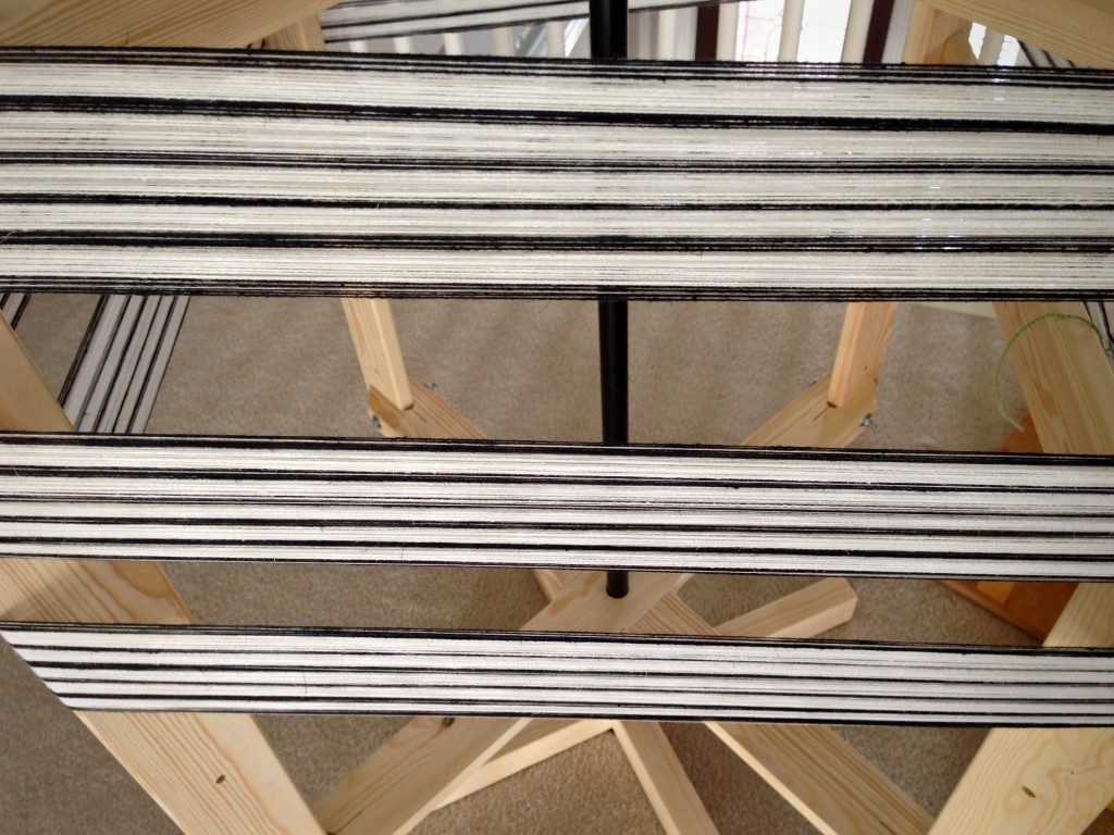 Warping reel with black and white warp.