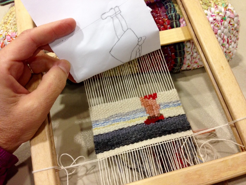 Small tapestry on portable frame loom.