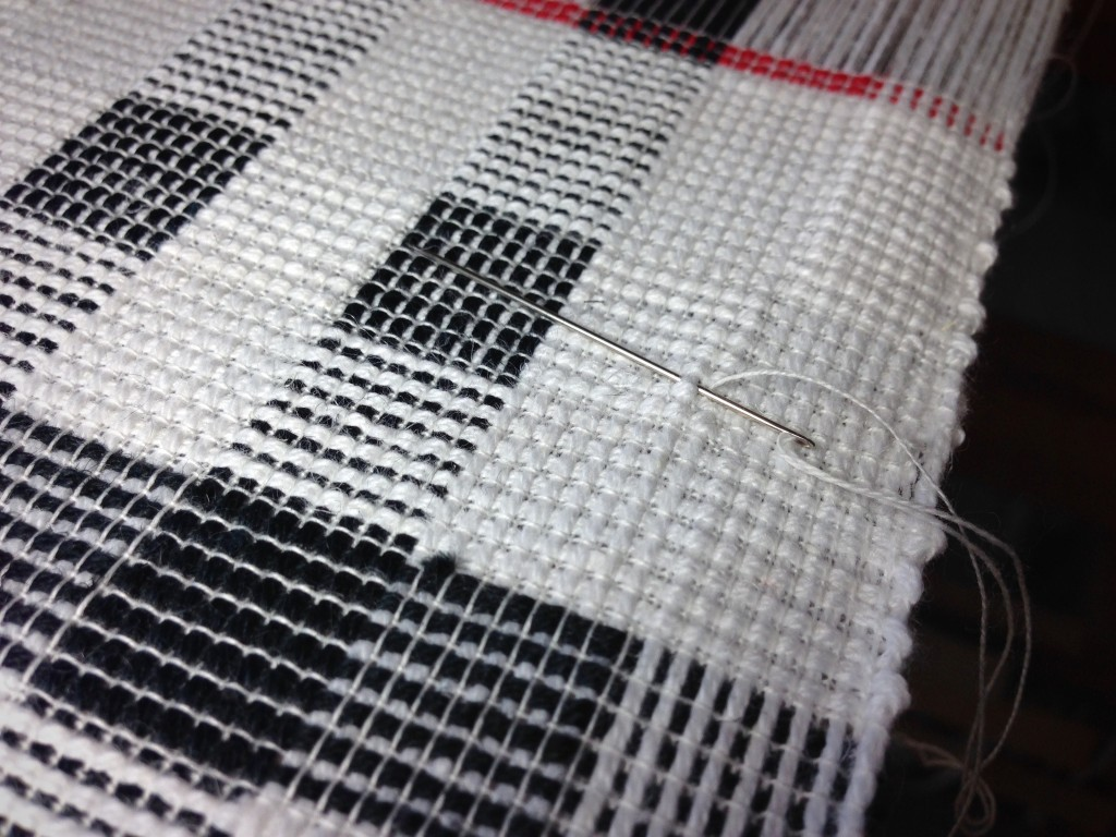 Replacing broken weft thread.