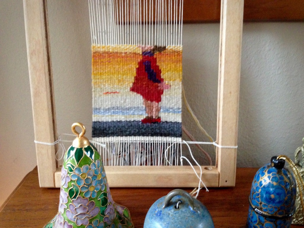 Little girl small tapestry progress.