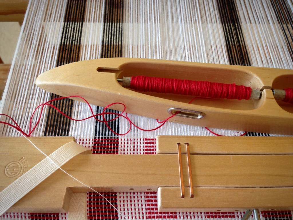 Hand towels on the loom with cotton/linen thread in the double bobbin shuttle.