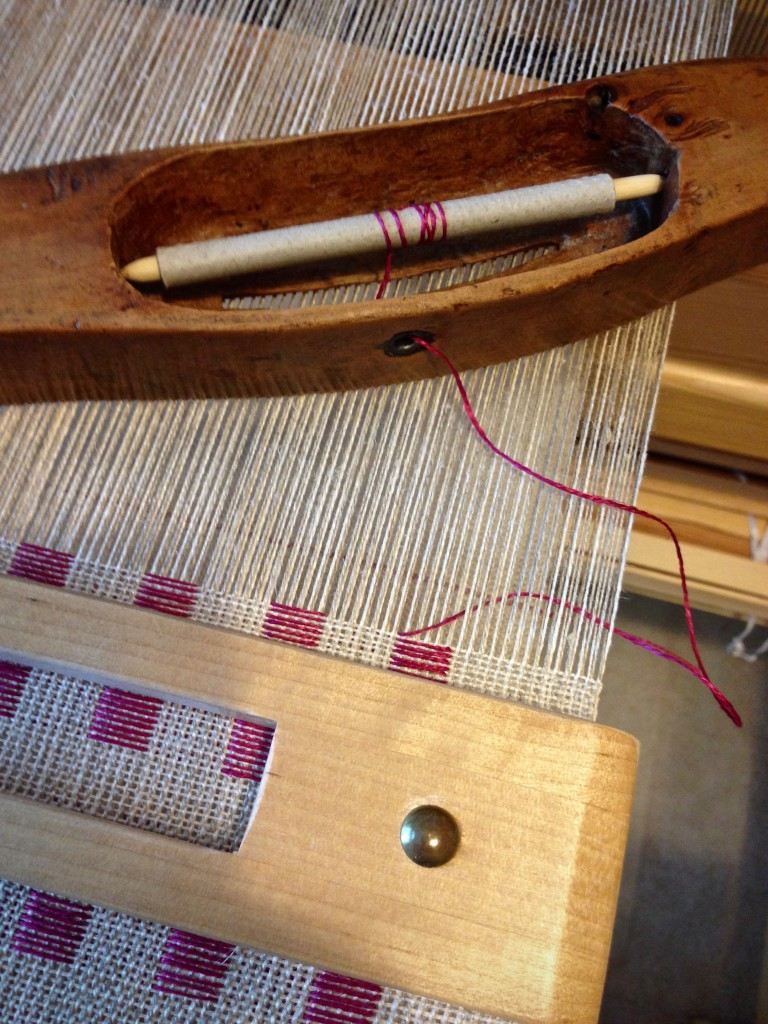 Linen dice weave on the loom.