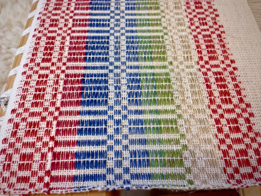 Sampling various linen color options for halvdräll table squares.