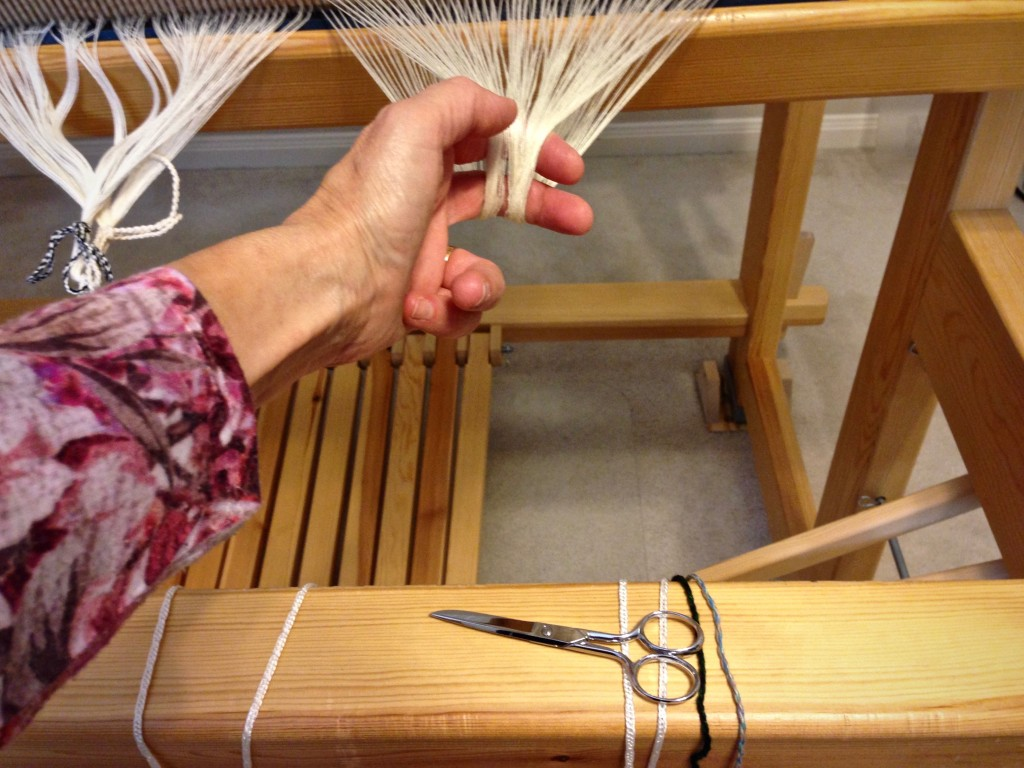 Cutting ends after beaming the warp.