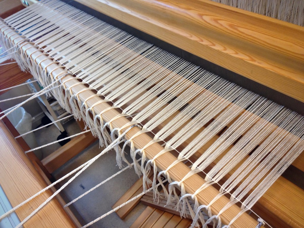 Cotton warp with leveling string, getting ready to weave monksbelt!