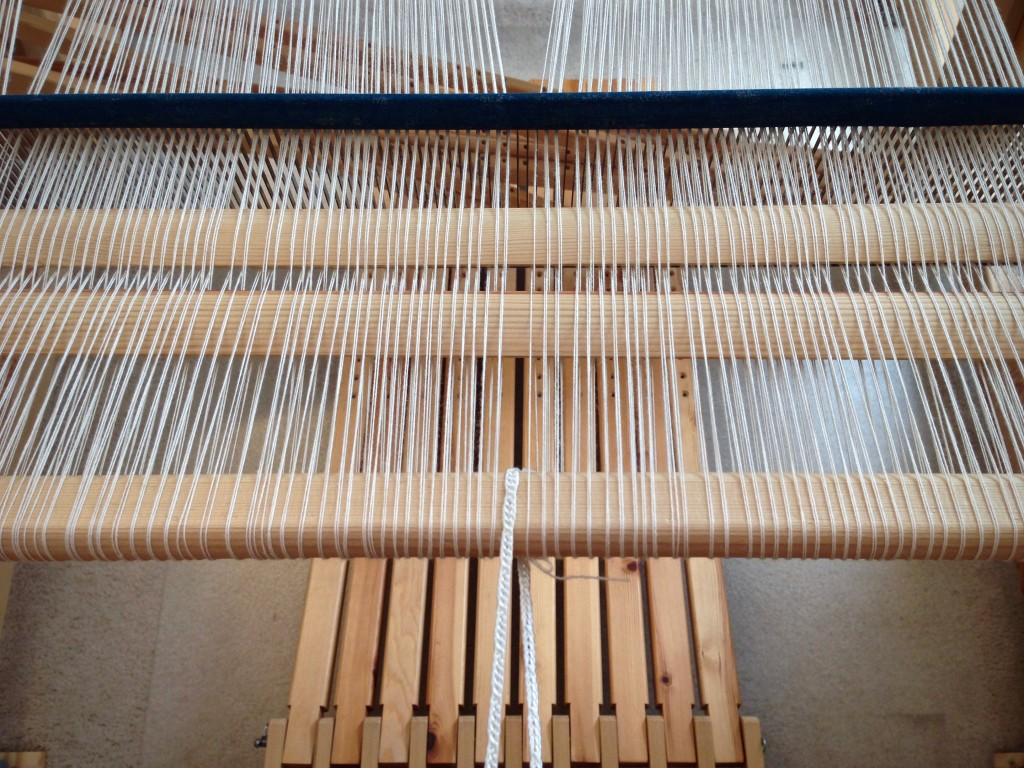 Winding on a new warp. Back to front warping pics.