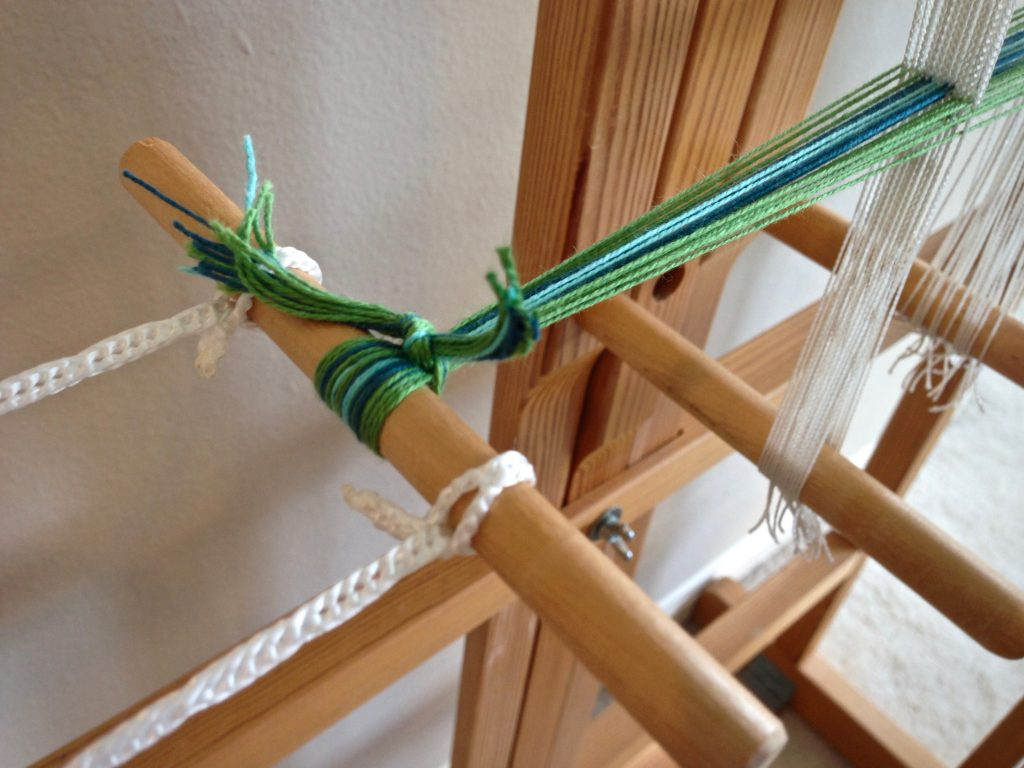Band loom ready for weaving.