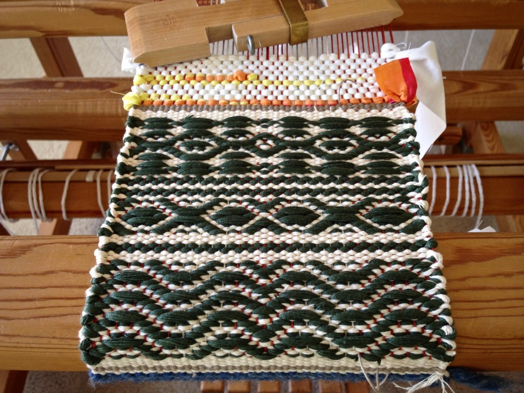 Sampler effect, rosepath mug rug, woven with stringyarn.