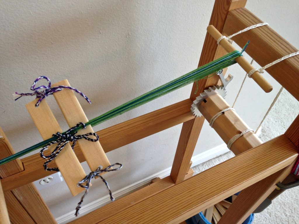 Warping the band loom tutorial.