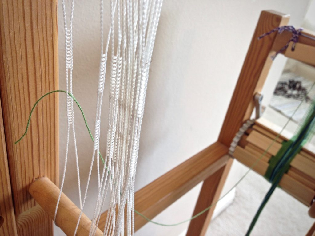 How to thread a band loom.