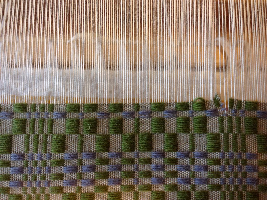 Weft threads are carefully snipped back to point of error.