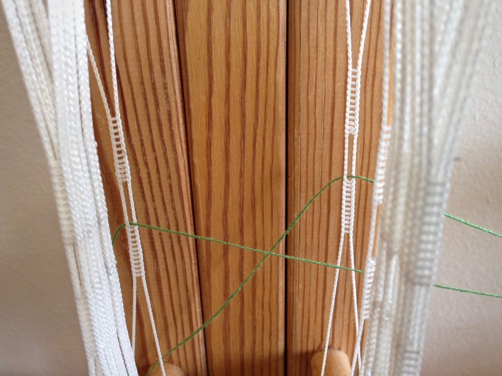 Threading the Glimakra band loom.