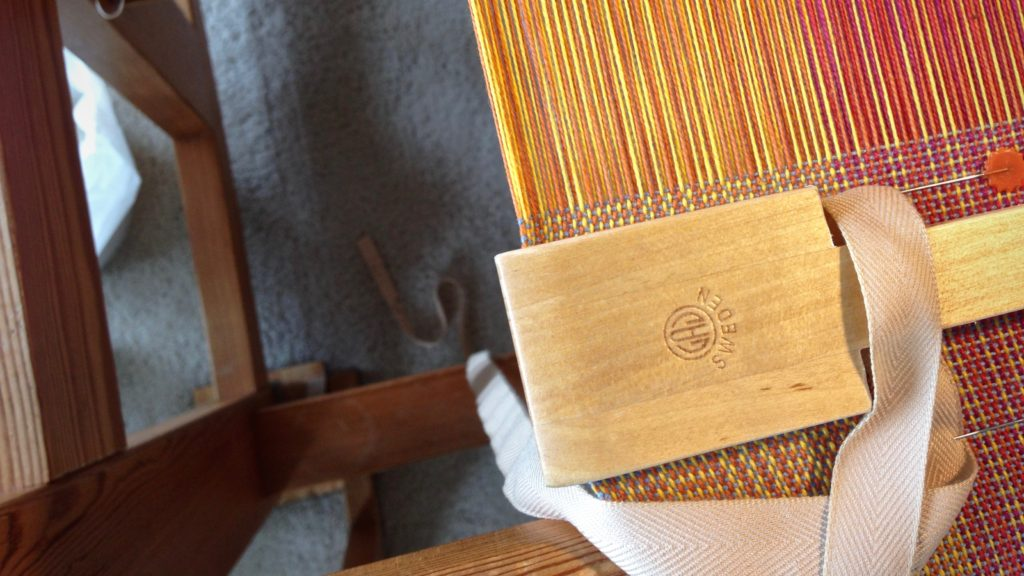 Twill tape for measuring length on the loom.