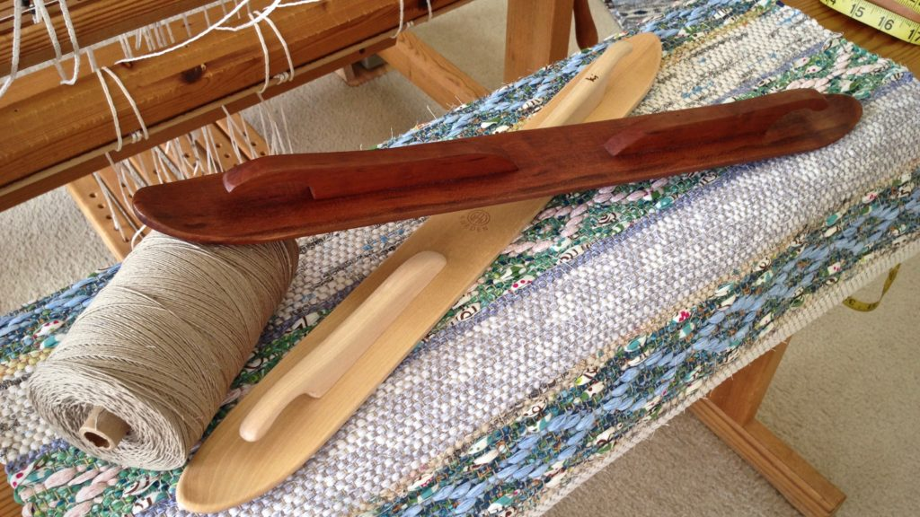 Hand crafted cherry wood ski shuttle, and rosepath rag rug just off the loom.