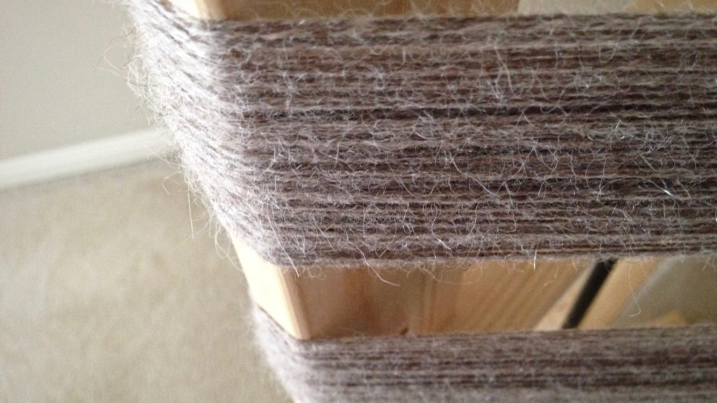 100% alpaca in a 3-ply yarn, preparing warp for weaving scarves.