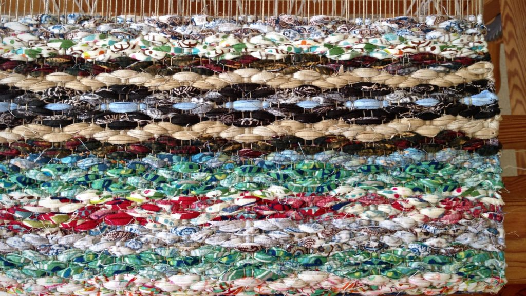 Rosepath rag rug on the loom.