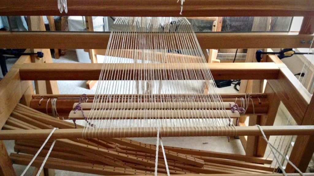 Beginning to beam a linen warp.